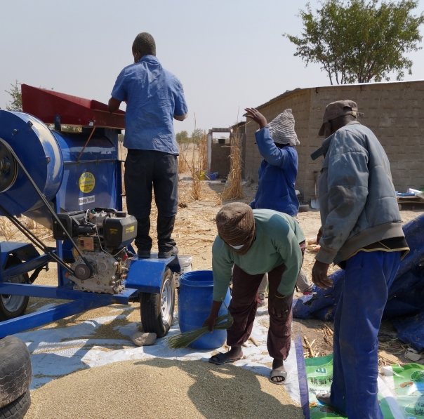 Locals gathered around the diesel thresher in Okathitu, Namibia.